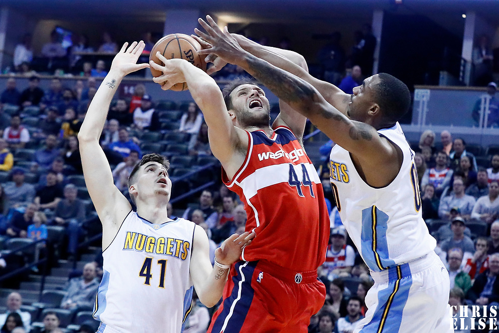08 March 2017: Denver Nuggets forward Darrell Arthur (00) defends on Washington Wizards guard Bojan Bogdanovic (44) during the Washington Wizards 123-113 victory over the Denver Nuggets, at the Pepsi Center, Denver, Colorado, USA.