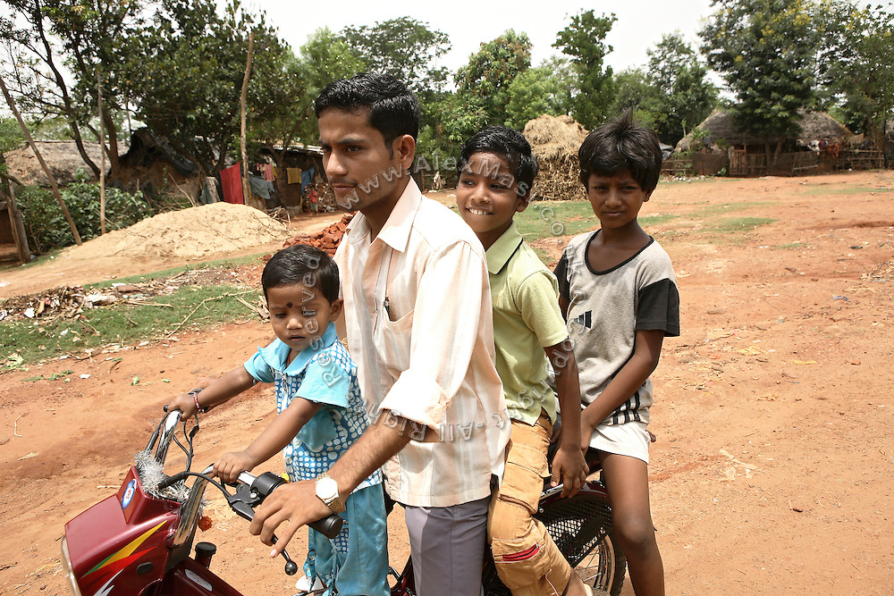 Budhia Singh, (second from right) 6, the famous Limca World Record marathoner, is enjoying a ride on a motorbike with a friend inside Salia Sahi slum (pop. 30.000) of Bhubaneswar, the capital of Orissa State, on Friday, May 16, 2008. On May 1, 2006, Budhia completed a record breaking 65 km run from Jagannath temple, Puri to Bhubaneswar. He was accompanied by his coach Biranchi Das and by the Central Reserve Police Force (CRPF). On 8th May 2006, a Government statement had ordered that he stopped running. The announcement came after doctors found the boy had high blood pressure and cardiological stress. As of 13th August 2007 Budhia's coach Biranchi Das was arrested by Indian police on suspicion of torture. Singh has accused his coach of beating him and withholding food. Das says Singh's family are making up charges as a result of a few petty rows. On April 13, Biranchi Das was shot dead in Bhubaneswar, in what is believed to be an event unconnected with Budhia, although the police is investigating the case and has made an arrest, a local goon named Raja Archary, which is now in police custody. **Italy and China Out**