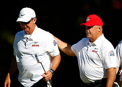 Former Ohio State head football coach Urban Myer reacts with Former Ohio State running back Jeff Logan during the Chick-fil-A Peach Bowl Challenge at the Ritz Carlton Reynolds, Lake Oconee, on Monday, April 30, 2019, in Greensboro, GA. (Paul Abell via Abell Images for Chick-fil-A Peach Bowl Challenge)