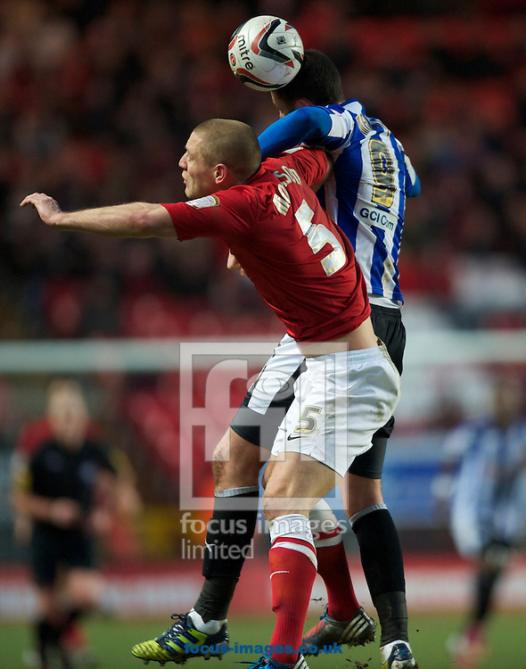 Picture by Alan Stanford/Focus Images Ltd +44 7915 056117.26/01/2013.Michael Morrison of Charlton Athletic and Gary Madine of Sheffield Wednesday during the npower Championship match at The Valley, London.