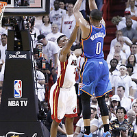 21 June 2012: Oklahoma City Thunder point guard Russell Westbrook (0) takes a jumpshot over Miami Heat point guard Norris Cole (30) during the Miami Heat 121-106 victory over the Oklahoma City Thunder, in Game 5 of the 2012 NBA Finals, at the AmericanAirlinesArena, Miami, Florida, USA. The Miami Heat wins the series 4-1.