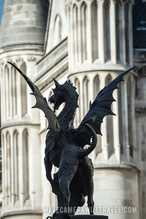 A statue of a dragon is silhouetted against columns of the buiilding behind it on Fleet Street in central London.