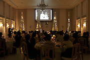 watching the church event video while at the wedding banquet