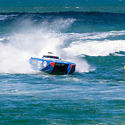 Brig, leads into a turn marker, Inboard Engine Class, in the Offshore Superboat Championships Coffs Harbour, New South Wales, Australia