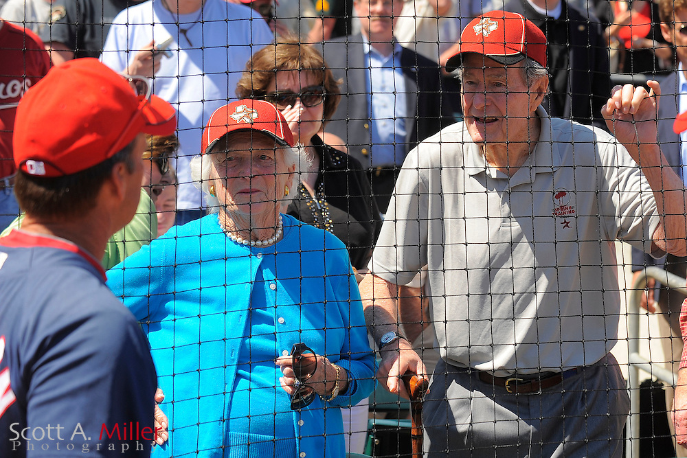 March 13, 2010; Kissimmee, FL, USA; Former President George H.W. Bush and former First Lady Barbara Bush talke with Washington Nationals manager Jim Riggleman  prior to the Nationals game against the Houston Astros at Osceola County Stadium. ©2010 Scott A. Miller