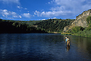 """081497-D. An angler fly fishes for trout in the """"canyon section"""" of the South Fork of the Snake River, Idaho."""