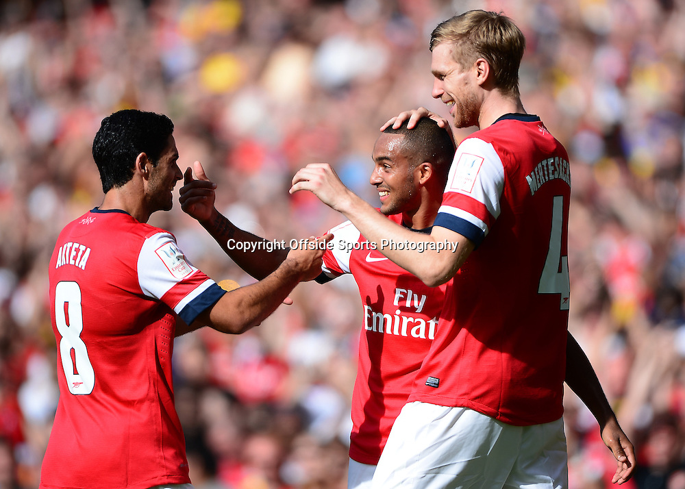 4th August 2013 - Emirates Cup - Arsenal v Galatasary - Theo Walcott of Arsenal celebrates scoring the opening goal with Mikel Arteta and Per Mertesacker - Photo: Marc Atkins / Offside.
