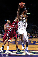 Kansas State forward Cartier Martin (20) drives to the basket for two of his game high 30 points, past Oklahoma's Bobby Maze (L) during second half action at Bramlage Coliseum in Manhattan, Kansas, March 3, 2007.  K-State beat Oklahoma 72-61.