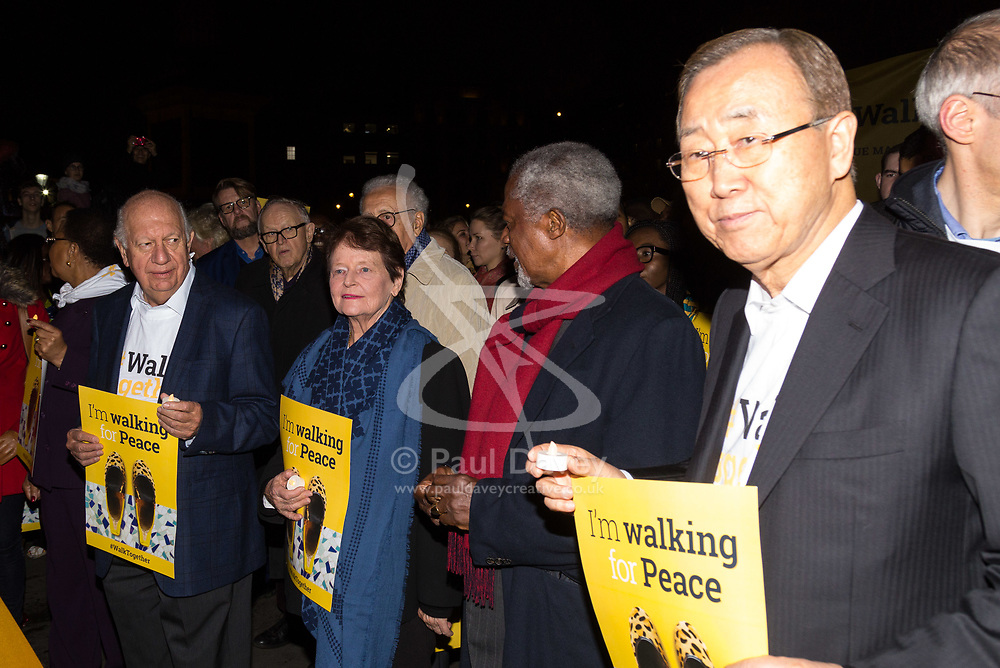 "London, October 23 2017. Nelson Mandela's group of Elders including former UN Secretary General Kofi Annan and Secretary General Ban Ki-moon accompanied by his widow Graca Machel gather at Parliament Square at the start of the Walk Together event in memory of Nelson Mandela before a candlelight vigil at his statue in Parliament Square. ""WalkTogether is a global campaign to inspire hope and compassion, celebrating communities working for the freedoms that unite us"". PICTURED: Mary Robinson, Kofi Annan and Ban Ki-Moon at the head of the march from Trafalgar Square to Parliament Square. © Paul Davey"