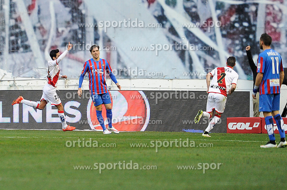 28.02.2015, Campo de Futbol, Madrid, ESP, Primera Division, Rayo Vallecano vs Levante UD, 25. Runde, im Bild Rayo Vallecano&acute;s Alberto Bueno celebrates a goal and Levante UD&acute;s Antonio Garcia Aranda despair // during the Spanish Primera Division 25th round match between Rayo Vallecano and Levante UD at the Campo de Futbol in Madrid, Spain on 2015/02/28. EXPA Pictures &copy; 2015, PhotoCredit: EXPA/ Alterphotos/ Luis Fernandez<br /> <br /> *****ATTENTION - OUT of ESP, SUI*****