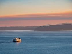 United States, Washington, Seattle, ferry in Puget Sound at sunset
