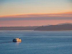 United States, Washington, Seattle, ferry in Puget Sound at sunset