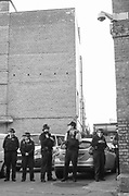 Six police officers in a carpark, Scumoween, Whitgift Street, Lambeth, London, UK, 31 October, 2015