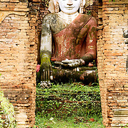 Statue at small temple of southern shore of Inle Lake