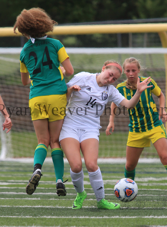In the Class 4 quarterfinal, Emma Edzards of Lee's Summit West, left, collides with Payton McCallister of Rock Bridge at Titans Stadium on Saturday. The Titans advanced past Rock Bridge 2-0 with an early goal and a late goal.