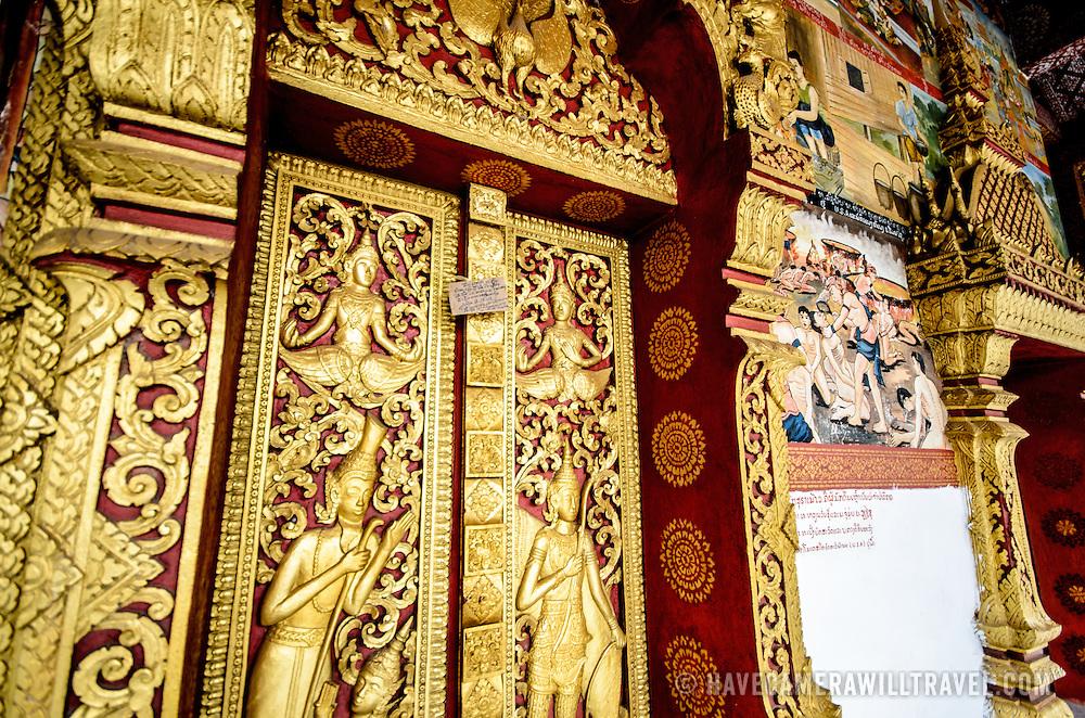 Ornate deocrations at Wat Phonxay Sanasongkham in Luang Prabang, Laos.