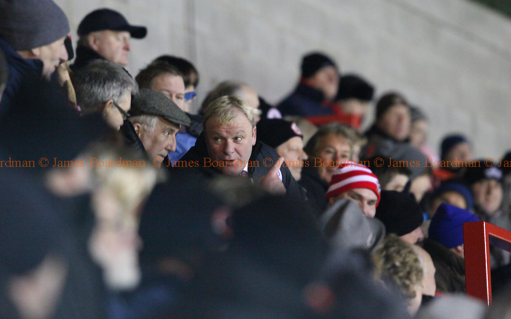 JAMES BOARDMAN / 07967642437.Crawley Manager Steve Evans watches the match from the stand after being sent off during the NPower League Two match between Crawley Town and Cheltenham Town at the Broadfield Stadium in Crawley. Febuary 07, 2012