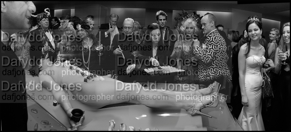 Terence Cole, Liz Brewer and Dame Shirley Bassey on left. Countess Gunilla von Bismarck and Gotfried von Bismarck,   Amanda from Playtime Platter lying on the table.  Andy & Patti Wong's Chinese New Year party to celebrate the year of the Rooster held at the Great Eastern Hotel, Liverpool Street, London.29th January 2005. The theme was a night of hedonism in 1920's Shanghai. . ONE TIME USE ONLY - DO NOT ARCHIVE  © Copyright Photograph by Dafydd Jones 66 Stockwell Park Rd. London SW9 0DA Tel 020 7733 0108 www.dafjones.com
