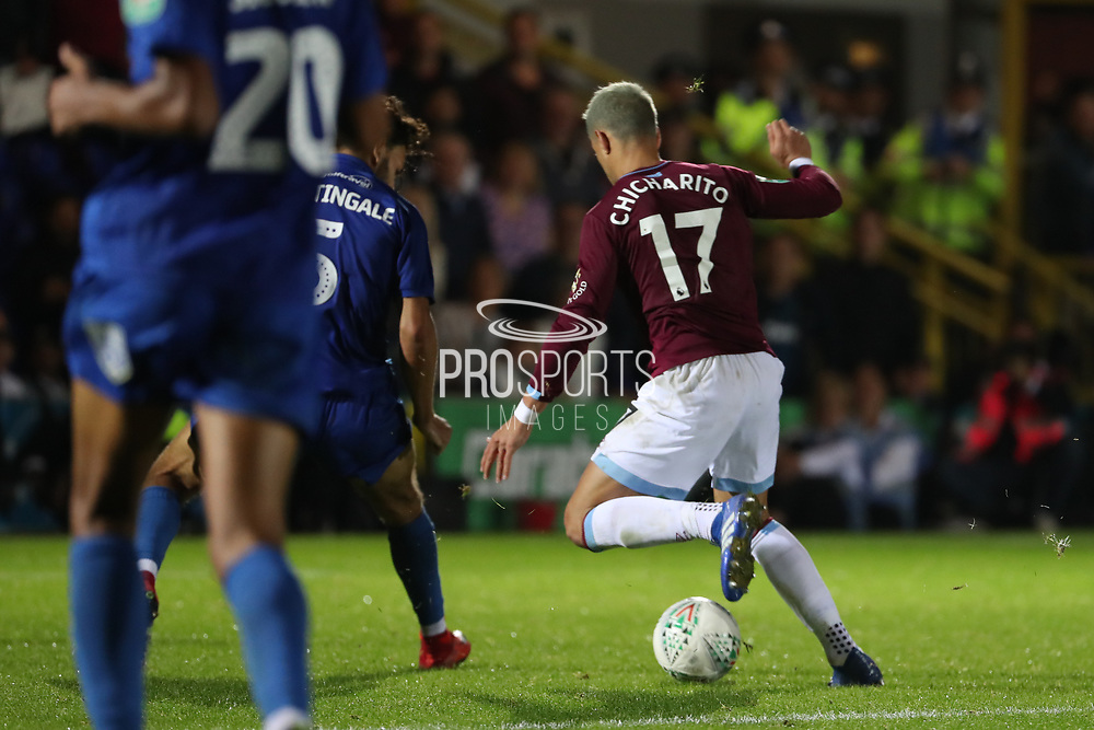 West Ham United attacker Javier Hernandez (17) about to score to make it 1-3 during the EFL Carabao Cup 2nd round match between AFC Wimbledon and West Ham United at the Cherry Red Records Stadium, Kingston, England on 28 August 2018.