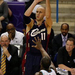 Mar 24, 2010; New Orleans, LA, USA; Cleveland Cavaliers center Zydrunas Ilgauskas (11) shoots over New Orleans Hornets center Emeka Okafor (50)during the second half at the New Orleans Arena. The Cavaliers defeated the Hornets 105-92. Mandatory Credit: Derick E. Hingle-US PRESSWIRE