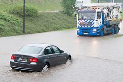 Car drives through the flood after heavy rain on September 17, 2010, in Ljubljana, Slovenia. (Photo by Matic Klansek Velej / Sportida)