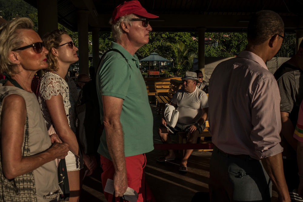 Tourists wait in line for ferries to take them to outer islands at a terminal in Victoria, Seychelles on February 20, 2018. Tourism is one of the country's main income generators.<br /> <br /> The government of Seychelles has created 81,000 square miles of Marine Protected Areas as part of a conservation debt swap deal in an effort to shield marine ecosystems from unsustainable development and climate change while safeguarding its economy.
