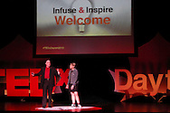 Emcees Kevin Moore of The Human Race Theatre Company (left) and Jane Black of the Dayton Art Institute deliver opening remarks during TEDx Dayton at the Victoria Theatre in downtown Dayton, Friday, November 15, 2013.  TEDx Dayton is a localized version, and uses a format similar to national TED (Technology, Entertainment, Design) events.
