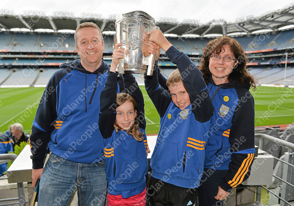 7 September 2013; On the eve of the All-Ireland Hurling Final, Clare hurling legend Jamesie O'Connor gave a unique tour of Croke Park stadium as part of the Bord Gáis Energy Legends Tour Series. Pictured holding the Liam MacCarthy Cup at the tour are the Jones Family, from left, Alfie, Áine, aged 8, Ciarán, aged 11, and Anne Marie, from Ennis, Co. Clare. The Final Bord Gáis Energy Legends Tour of the year will take place on Saturday, 21st September and will feature former Mayo player, Willie Joe Padden. Full details are available on www.crokepark.ie/events. Croke Park, Dublin. Picture credit: Barry Cregg / SPORTSFILE *** NO REPRODUCTION FEE ***