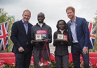 Daniel Wanjiru KEN and Mary Keitany KENon the podium with Rob Diver and HRH Prince Henry of Wales (Prince Harry) following their wins in the Elite Races. The Virgin Money London Marathon, 23rd April 2017.<br /> <br /> Photo: Jed Leicester for Virgin Money London Marathon<br /> <br /> For further information: media@londonmarathonevents.co.uk