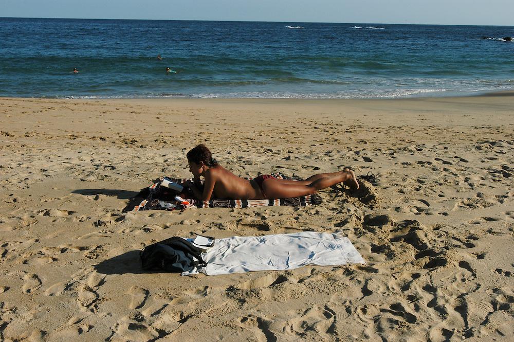 A sun bather on the beach...Mazunte Playa, Oaxaca, Mexico. 18/01/2004...Photo © J.B. Russell