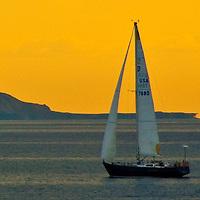 A boat sails south at Santa Monica Bay on Saturday, December 17, 2011.