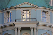 Detail of the facade of the Schloss Charlottenburg or Charlottenburg Palace, with atlantes surrounding window openings and Corinthian capitals on columns supporting the balcony, built 1695-1713 by Johann Arnold Nering in Baroque and Rococo style, Charlottenburg, Charlottenburg-Wilmersdorf, Berlin, Germany. The original palace was commissioned by Sophie Charlotte, the wife of Friedrich III, Elector of Brandenburg and later Friedrich I of Prussia. Prussian rulers occupied the palace until the late 19th century. After being badly damaged in the war, the palace was restored and is now a major tourist attraction. Picture by Manuel Cohen