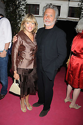 Australian award winning jewellery designer John Calleija and special guest Claudia Schiffer hosted the launch party of Calleija's new London store in the Royal Arcade, Old Bond Street, London on 24th June 2008.<br /><br />Picture shows:-Fashion designer EDINA RONAY and her husband MR DICK POLAK.
