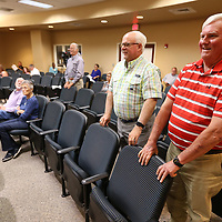Bob Baughn, right, and John Hines stand as they are annoounced, along with others, as Tupelo Police Advisory Board Members during the Tupelo City Council meeting Tuesday night.