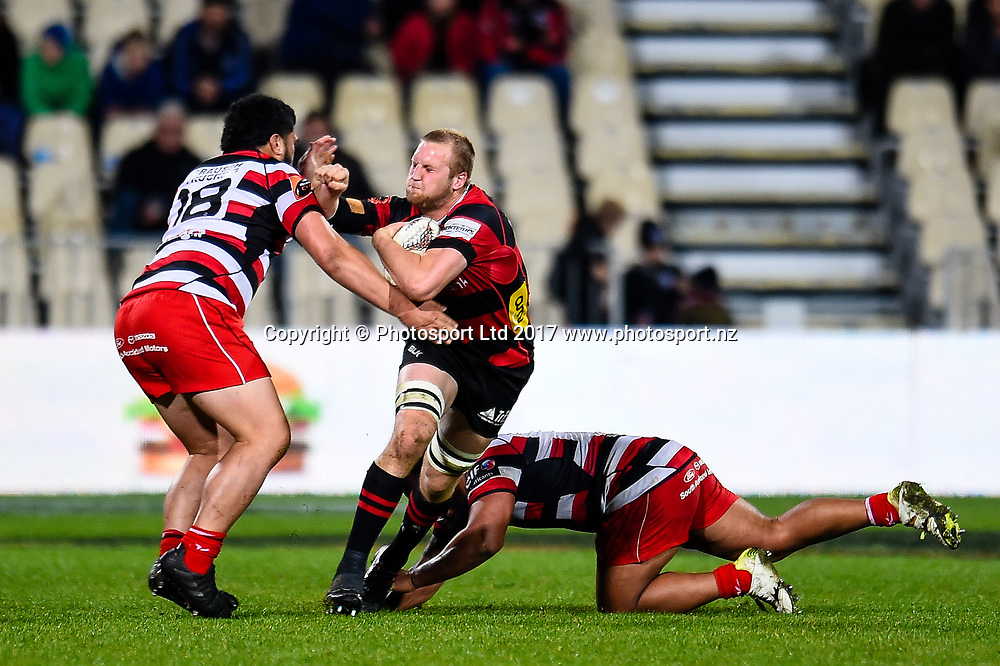 Mitchell Dunshea of Canterbury is tackled by Coree Te Whata-Colley and Pauliasi Manu of Counties Manukau during the Ranfurly Shield and Mitre 10 Cup rugby match Canterbury V Counties Manukau, AMI Stadium, Christchurch, New Zealand, 13th September 2017.Copyright photo: John Davidson / www.photosport.nz