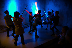 "© Licensed to London News Pictures . 06/12/2015 . Manchester , UK . A lightsaber fight breaks out in the cantina . Fans attend Star Wars exhibition "" For the Love of the Force "" at Bowlers Exhibition Centre in Manchester . Photo credit : Joel Goodman/LNP"