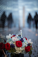 Flowers lay next to the Vietnam War Memorial in Washington DC on February 28, 2018. (© Photo by Jakub Mosur).
