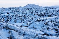 Óbrynnishólabruni lava field in winter, mount Helgafell in background. Iceland.