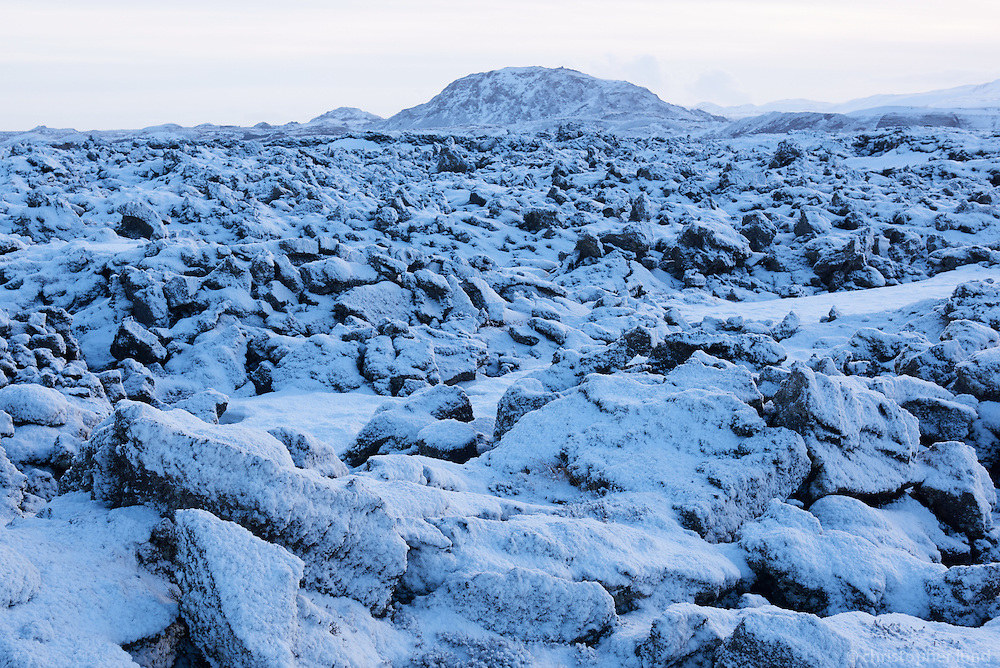Óbrynnishólabruni lava field in winter, mount Helgafell in background. Iceland.