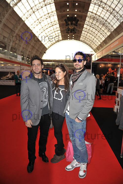 Spencer Matthews, Millie Mackintosh and Hugo Taylor..Attending Erotica 2011, Olympia Hall, Kensington, London, England. 18 November 2011. Contact: rich@piqtured.com  +44(0)7941 079620 (Picture by Awais Butt)