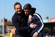 AFC Wimbledon manager Neal Ardley hugging Bristol Rovers Manager Darrell Clarke during the EFL Sky Bet League 1 match between AFC Wimbledon and Bristol Rovers at the Cherry Red Records Stadium, Kingston, England on 8 April 2017. Photo by Matthew Redman.