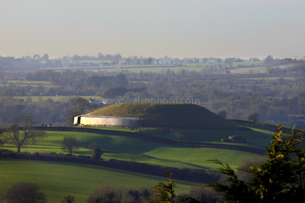 Newgrange, seen from the top of another nearby tumulus, Dowth. Newgrange is a UNESCO World Heritage Site, and dates to some 5,000 years ago...