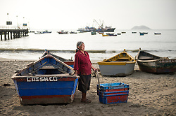 Irene Reyes Garcia, 74, works in the coastal town of Coishco Viejo, Ancash, Peru, renting plastic cases to fishermen.
