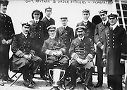 Captain Arthur Rostron and under officers of RMS Carpathia (Cunard), with loving cup presented to him by survivors of wreck of RMS Titanic (White Star Line),  12 April 1912 in recognition of  his heroism in the rescue. Shipwreck Disaster