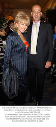 MR JEREMY NEVILLE and his wife SALLY FARMILOE former close friend of Lord Archer, at a reception in London on 8th October 2002.PDU 59