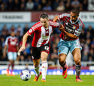 Winston Reid of West Ham United holds Marc McNulty of Sheffield United during the Capital One Cup match at the Boleyn Ground, London<br /> Picture by David Horn/Focus Images Ltd +44 7545 970036<br /> 26/08/2014