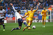 Preston North End Striker Callum Robinson challenged by Bolton Defender Derik Osede during the Sky Bet Championship match between Bolton Wanderers and Preston North End at the Macron Stadium, Bolton, England on 12 March 2016. Photo by Pete Burns.