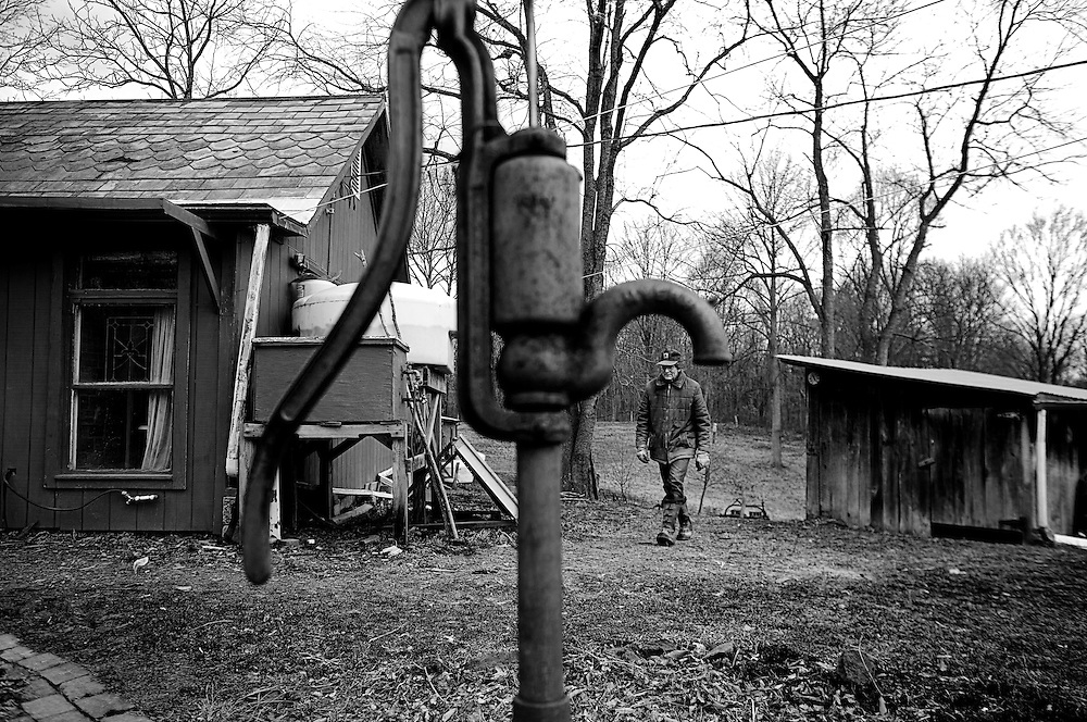 Ed Perkins walks back to his house in New Marshfield, OH on February 10, 2008. Ed is a sustainable living farmer who heats his house with wood from his farm, pumps his own water with an antiquated hand-pump and sells his produce at the local Farmer's Market in Athens, OH.