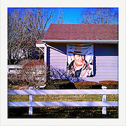 Banner of John Wayne hangs at his birthplace Sunday, January 1, 2012, in Winterset, IA...Photo by Khue Bui
