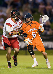 Virginia attackman Ben Rubeor (6) is defended by Maryland midfielder Max Schmidt (19).  The #3 ranked Virginia Cavaliers defeated the #8 ranked Maryland Terrapins 11-8 in the semi finals of the Men's 2008 Atlantic Coast Conference tournament at the University of Virginia's Klockner Stadium in Charlottesville, VA on April 25, 2008.